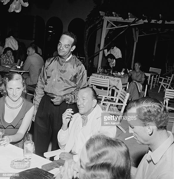 English singer songwriter actor and playwright Noel Coward with friends at Sunset Lodge Jamaica circa 1953 With him are Pam Akers and British author...