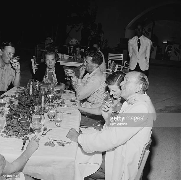English singer songwriter actor and playwright Noel Coward with friends at Sunset Lodge Jamaica circa 1953 With him are British author Ian Fleming...