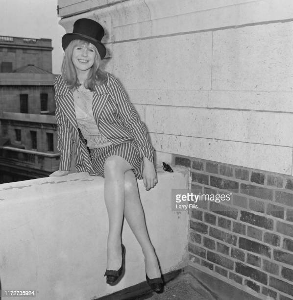 English singer, songwriter, and actress Marianne Faithfull wearing a top hat, UK, 20th May 1965.