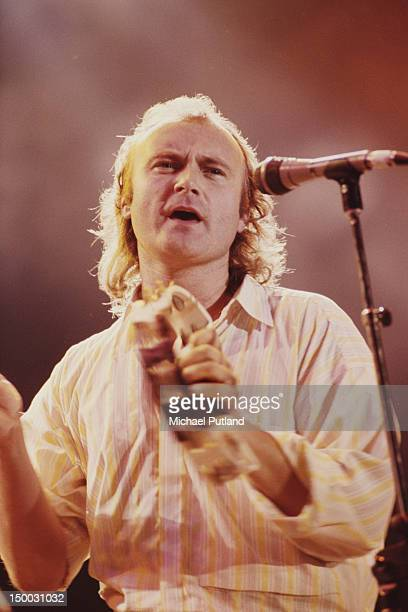 English singer songwriter and drummer Phil Collins performing on stage circa 1985