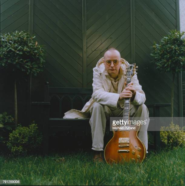 English singer songwriter and guitarist Andy Partridge formerly of XTC holding an Ibanez electric guitar at home in Swindon Wiltshire March 2000
