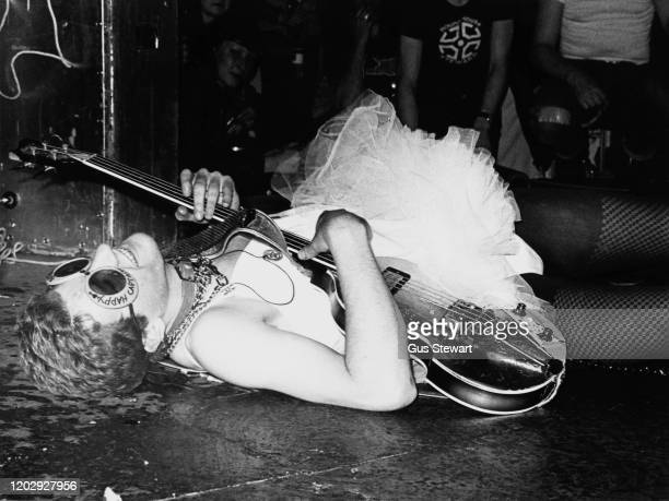 English singer songwriter and guitarist Captain Sensible of punk band The Damned performs on stage wearing ballerina costume UK circa 1977