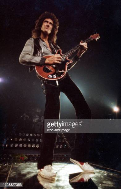 English singer songwriter and lead guitarist for the rock band Queen Brian May onstage at Cobo Arena on November 18 in Detroit Michigan