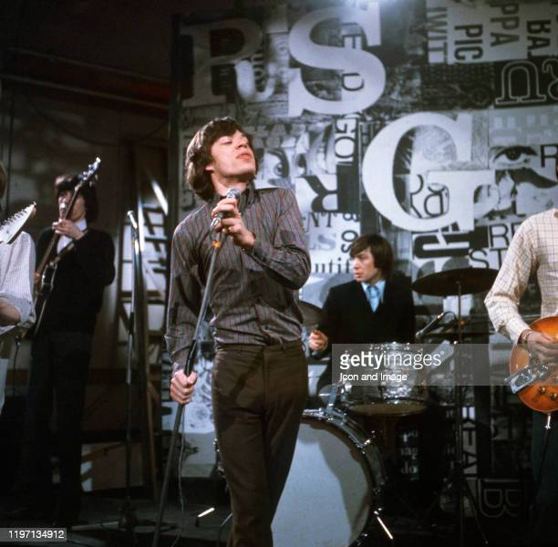 """English singer, songwriter and lead singer of the Rolling Stones, Mick Jagger, performs at the Kingsway Studios on the ITV show """"Ready Steady Go!"""" on..."""