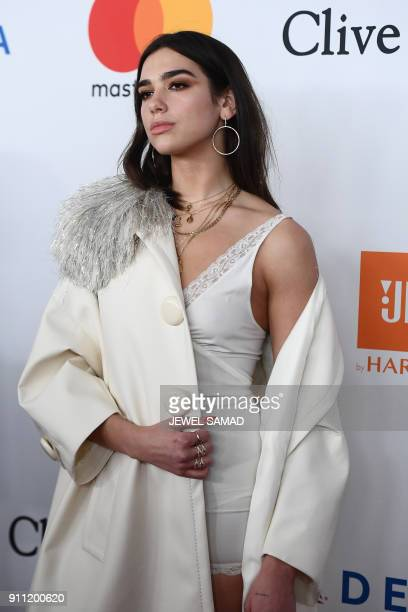 English singer songwriter and model Dua Lipa arrives for the traditionnal Clive Davis party on the eve of the 60th Annual Grammy Awards on January 28...