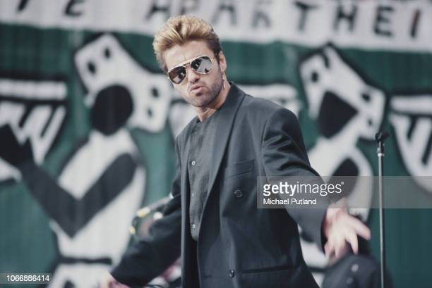 English singer, songwriter and musician, George Michael performs live on stage at the Nelson Mandela 70th Birthday Tribute concert at Wembley Stadium...