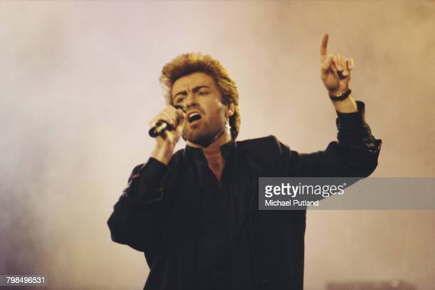English singer, songwriter and musician, George Michael performs live on stage at an Aids awareness charity concert at Wembley Arena in London in...