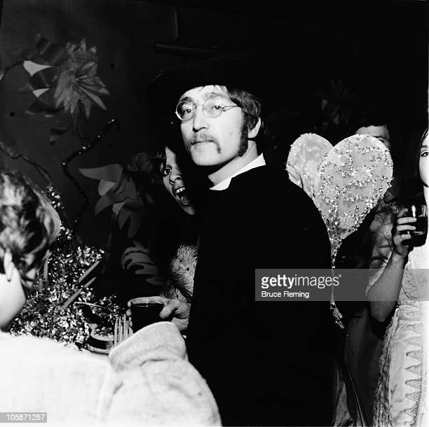 English singer songwriter and musician John Lennon dressed as a priest for a fancy dress party at the Cromwellian Club London 8th January 1967 He is...