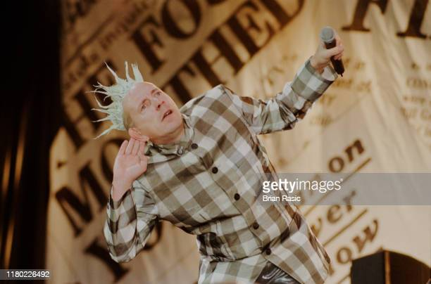 English singer, songwriter and musician John Lydon performs live on stage with punk group Sex Pistols at Finsbury Park in London during the band's...