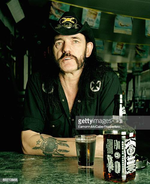 English singer, songwriter and musician Lemmy of Motorhead enjoys a glass of Jack Daniels and ice at the Rainbow Bar and Grill on Sunset Boulevard in...