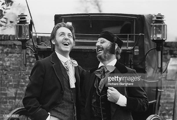 English singer songwriter and musician Paul McCartney with drummer Ringo Starr in period costume for a scene in the film 'Give My Regards to Broad...