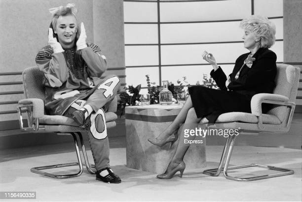 English singer, songwriter, DJ and fashion designer Boy George interviewed by Northern Irish television presenter Gloria Hunniford on ITV television...