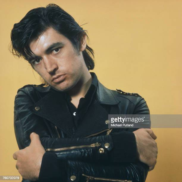 English singer, songwriter, musician, and producer, Chris Spedding posed wearing a leather biker jacket in October 1975.
