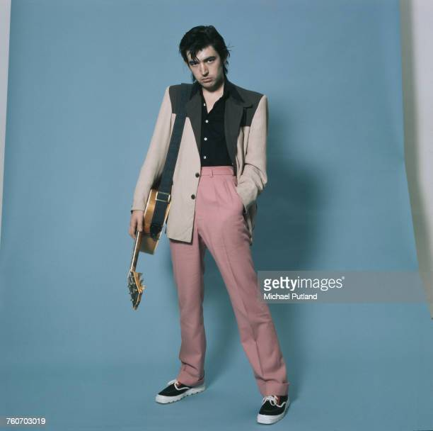 English singer, songwriter, musician, and producer, Chris Spedding posed with a Gibson acoustic guitar in October 1975.