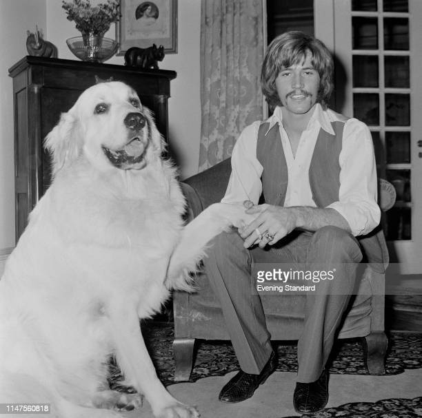 English singer songwriter musician and record producer Barry Gibb of the Bee Gees with his Pyrenean Mountain dog Barnaby UK 3rd October 1969