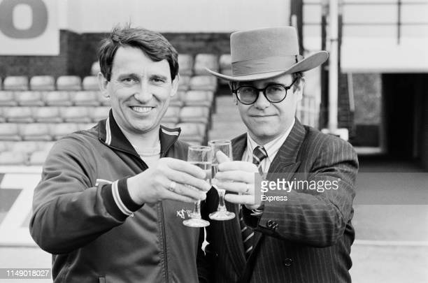 English singer, songwriter, pianist, and composer Elton John, chairman of Watford FC, celebrating with Watford FC manager Graham Taylor ahead of the...