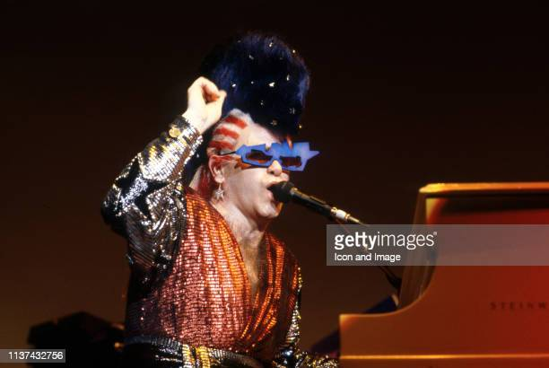English singer songwriter pianist and composer Sir Elton John performs at Pine Knob Music Thater on August 17 in Clarkston Michigan