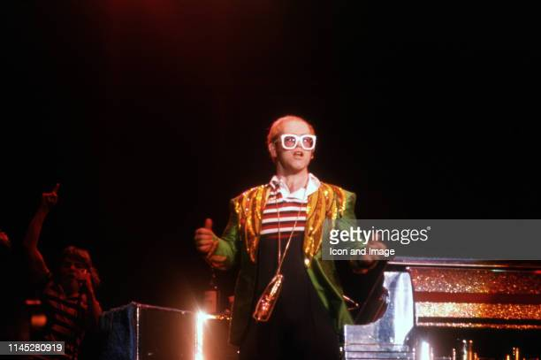 English singer songwriter pianist and composer Sir Elton John performs at the Pontiac Silverdome during his Louder Than Concorde tour on July 11 in...