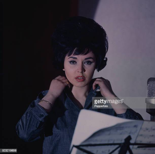 English singer Susan Maughan pictured in a recording studio in 1963