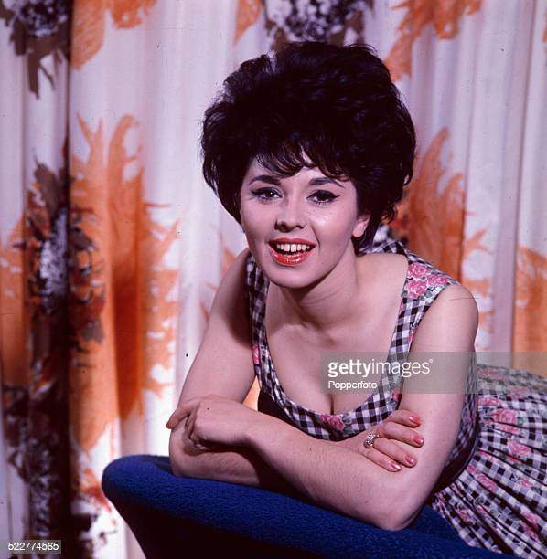 English singer Susan Maughan posed wearing a gingham dress in 1963
