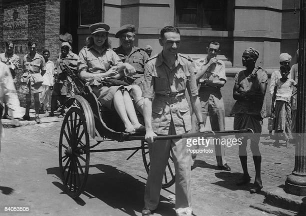 English singer Vera Lynn and comedian Stainless Stephen riding in a rickshaw pulled by Lynn's pianist Len Edwards during an ENSA tour of India to...