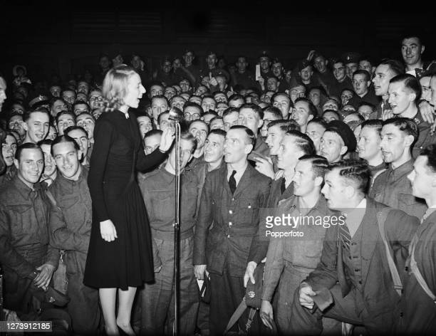 English singer Vera Lynn , known as 'the Forces' Sweetheart', entertains troops and members of the British armed forces during a concert somewhere in...