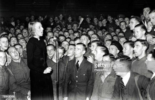 Volume 2 Page 128 Picture 1 World War Two Forces Sweetheart Vera Lynn sings into a microphone to entertain the troops during the war