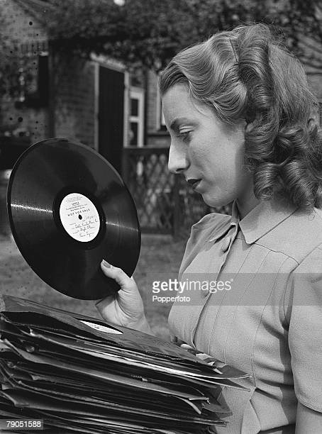 England WWII Forces Sweetheart singer Vera Lynn poses for a photoshoot at her home Here she can be seen sorting through a stack of long playing...