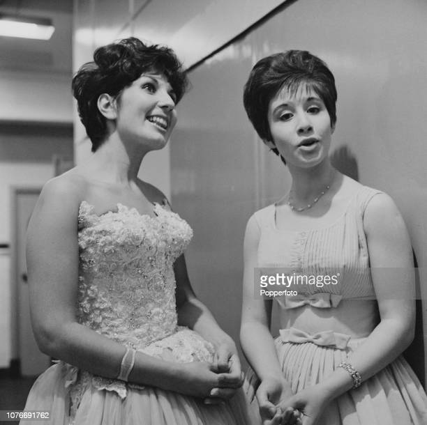 English singers Alma Cogan and Helen Shapiro on right pictured backstage during the recording of an ATV Television show in London in August 1961