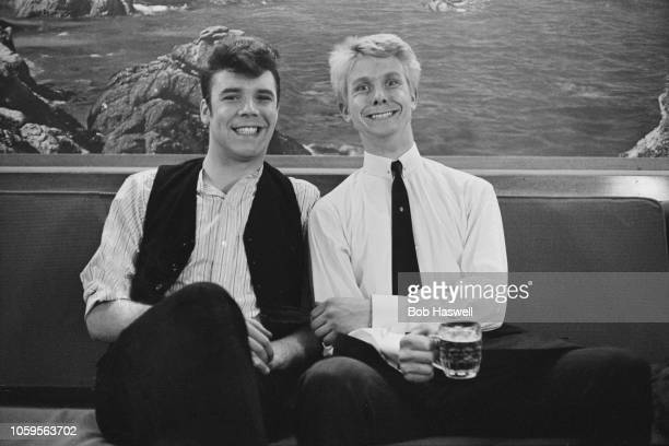 English singers and musicians Marty Wilde and Joe Brown pictured together during production of the film 'What a Crazy World' in England on 2nd May...