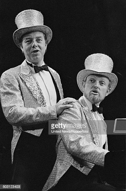 English singers and pianists Peter Skellern and Richard Stilgoe perform songs from their album 'Who Plays Wins' in London on 25th September 1985.