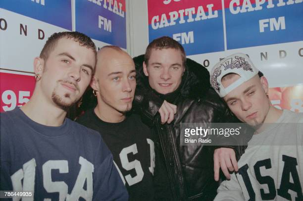 English singers from left Terry Coldwell John Hendy Tony Mortimer and Brian Harvey of boy band East 17 posed together at the Capital Radio Christmas...