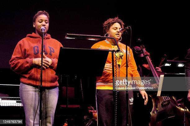 English singers Marsha Ambrosius and Natalie Stewart of Floetry perform live on stage at the Barbican in London on 21st April 2003.