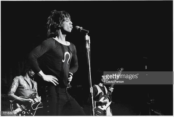 English singers musicians and songwriters Mick Jagger Keith Richards and Bill Wyman of the rock band 'The Rolling Stones' perform on stage at Madison...