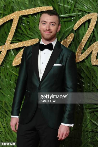 English singersomgwriter Sam Smith poses on the red carpet upon arrival to attend the British Fashion Awards 2017 in London on December 4 2017 / AFP...