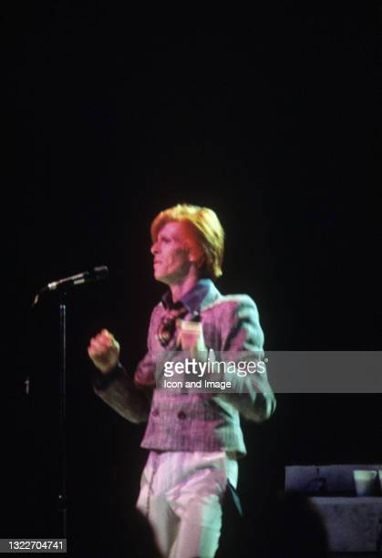 """English singer-songwriter and actor, David Bowie , performs at the Tower Theater during his """"Diamond Dogs Tour"""" on July 8 in Upper Darby, PA."""