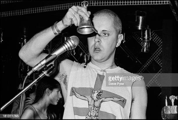 English singersongwriter and artist Genesis POrridge using a hand bell at the first British performance by experimental music group Psychic TV at the...