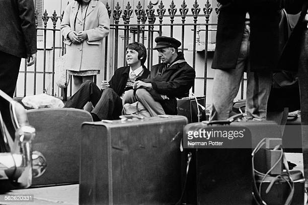 English singersongwriter and Beatles bassist Paul McCartney waiting on the pavement in Allsop Place for a coach to take him on a filming trip in the...