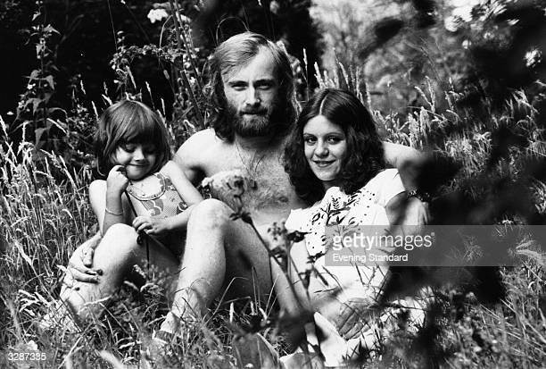 English singersongwriter and drummer with rock group Genesis Phil Collins with his first wife Andrea Bertorelli and her four year old daughter Joely...