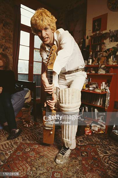 English singersongwriter and guitarist Captain Sensible formerly of punk group The Damned at home with a guitar shaped like a cricket bat UK February...