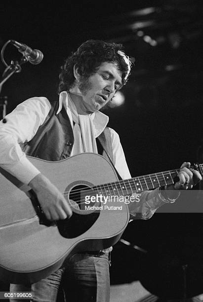 English singersongwriter and guitarist Ronnie Lane performing with Slim Chance at The Great British Music Festival Olympia London 2nd January 1976