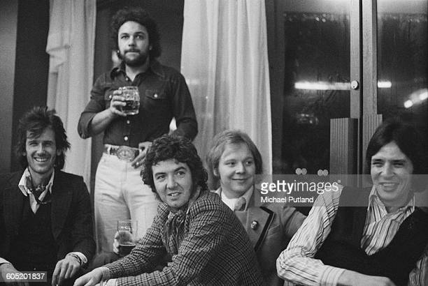 English singersongwriter and guitarist Ronnie Lane with his band Slim Chance 6th January 1976 Left to right Charlie Hart Steve Simpson Ronnie Lane...
