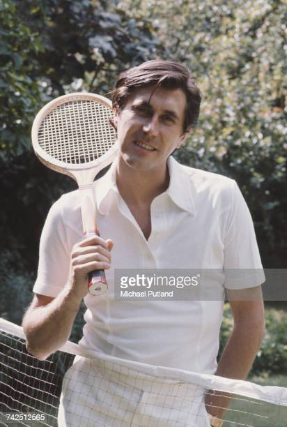 English singersongwriter and lead singer of Roxy Music Bryan Ferry pictured in tennis gear holding a tennis racket at his home in London 16th July...