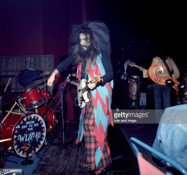 English singersongwriter and multiinstrumentalist Roy Wood of the Glam Rock group Wizzard plays his guitar on stage during a show circa 1972 in...