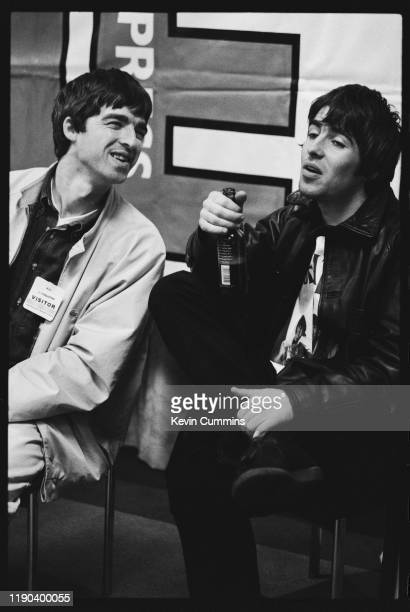 English singer-songwriter and musician Noel Gallagher and English singer-songwriter Liam Gallagher of rock group Oasis at an event organised by the...