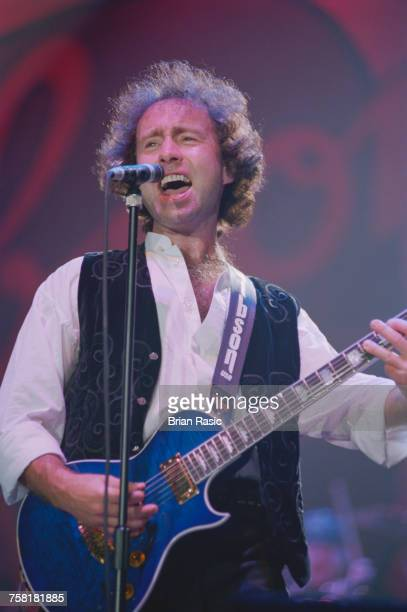 English singersongwriter and musician Paul Rodgers performs live on stage at the Gibson Night of 100 Guitars centenary concert at Wembley Arena in...