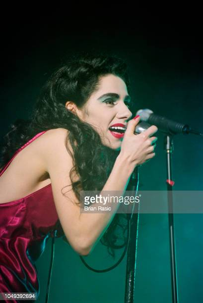 English singersongwriter and musician PJ Harvey performs live on stage at Shepherd's Bush Empire in London on 11th March 1995
