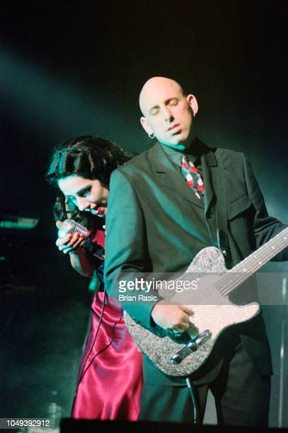 English singersongwriter and musician PJ Harvey performs live on stage with guitarist Joe Gore at Shepherd's Bush Empire in London on 11th March 1995