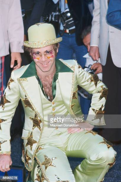 English singersongwriter and pianist Elton John is honoured with a star on the Hollywood Walk of Fame at 6915 Hollywood Boulevard Los Angeles 23rd...