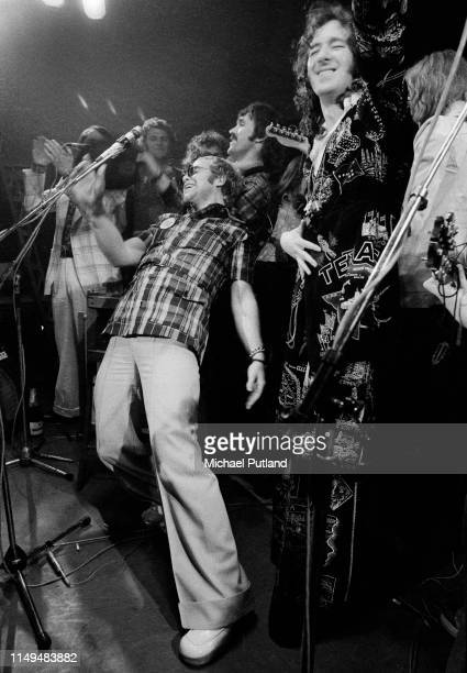English singersongwriter and pianist Elton John performs on stage with from left manager John Reid Tony King Muff Winwood and Neil Innes at the...